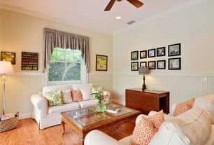 Traditional Living Room with Crown molding, Hardwood floors, Wainscotting, Ceiling fan