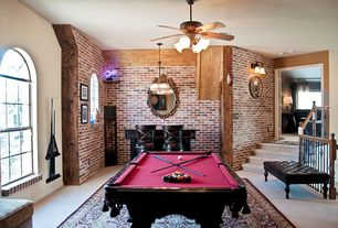 Traditional Game Room with Standard height, Ceiling fan, Pendant light, double-hung window, interior brick, Concrete floors