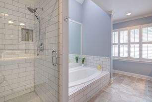 Modern Master Bathroom with Pental - Lozoya Brushed Limestone Tile, Pental - subway tile in glossy white, Handheld showerhead
