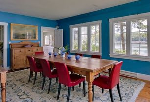 Cottage Dining Room with Hardwood floors