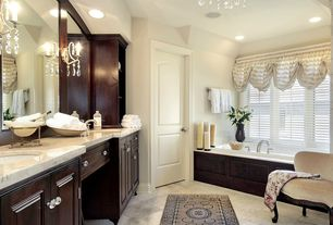 Traditional Master Bathroom with Master bathroom, Undermount sink, stone tile floors, can lights, Raised panel, Double sink