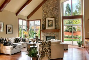 Craftsman Great Room with Exposed beam, Fireplace, Built-in bookshelf, Arched window, French doors, stone fireplace