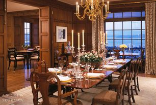 Craftsman Dining Room with Hardwood floors, Crown molding, Chandelier