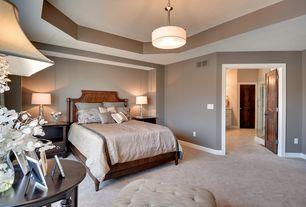 Traditional Master Bedroom with Tufted ottoman, Carpet, Tray ceiling, Decorative ceiling, High ceiling, Pendant light