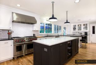 Traditional Kitchen with Hardwood floors, Pendant light, Wine refrigerator, Subway Tile, L-shaped, Glass panel, Breakfast bar