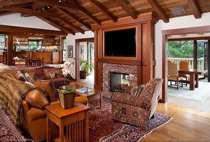 Craftsman Living Room with Hardwood floors, brick fireplace, Fireplace, Exposed beam, Standard height, flush light