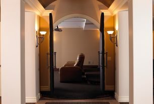 Traditional Hallway with Columns, Concrete floors, specialty door, Wall sconce