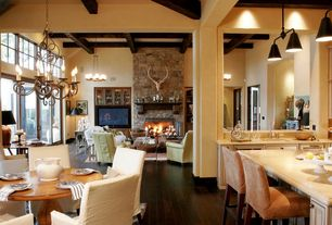 Rustic Great Room with Exposed beam, Columns, Hardwood floors, Pendant light, French doors, Chandelier, Built-in bookshelf