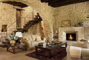Mediterranean Living Room with stone fireplace, MS International Sunny Dark Limestone, LedgeCut33, Exposed beam