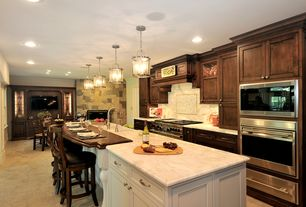 Traditional Kitchen with Pendant light, limestone tile floors, Kitchen island, Farmhouse sink, Inset cabinets, Complex Marble