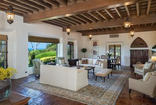 Mediterranean Living Room with Standard height, Casement, Interlocking Pavers, Exposed beam, flush light