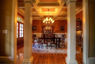 Traditional Dining Room with Chair rail, Built-in bookshelf, Exposed beam, Hardwood floors, Box ceiling, Standard height