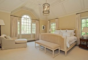 Traditional Master Bedroom with Eloquence dauphine bed - beach house natural, Chandelier, High ceiling, Arched window, Carpet