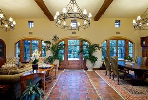 Mediterranean Great Room with stone tile floors, Exposed beam, Standard height, Arched window, sandstone tile floors