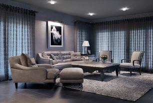 Modern Living Room with stone tile floors, slate tile floors, specialty window, Wall sconce, can lights, Standard height
