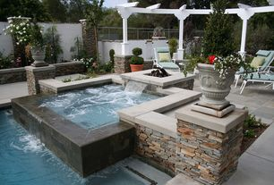 Contemporary Hot Tub with exterior tile floors, Raised beds, Fence, Trellis