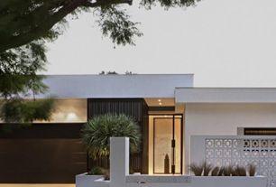 Modern Exterior of Home with Cinder block walls, Concrete decorative block, Pivot door, Contemporary custom garage door