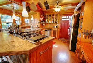 Country Kitchen with flush light, Limestone tile counters, Deluxe magnetic knife bar, limestone floors, Le Creuset Dutch Oven
