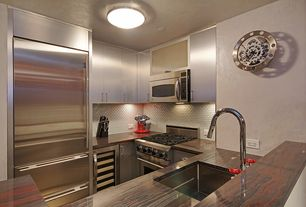 Contemporary Kitchen with Glass Tile, flush light, Onyx counters, Paint, U-shaped, Built In Refrigerator, Glass panel, Flush