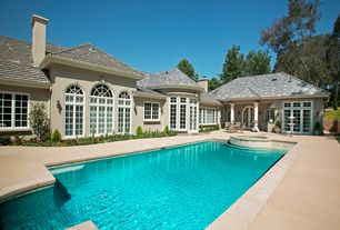 Traditional Swimming Pool with exterior concrete tile floors, French doors, Pool with hot tub, Casement, Arched window