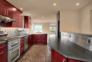 Contemporary Kitchen with slate tile floors, European Cabinets, Metal Tile, Simple granite counters, Undermount sink, Flush