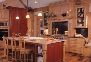 Country Kitchen with High ceiling, Slate counters, Simple granite counters, Hardwood floors, Kitchen island, Exposed beam