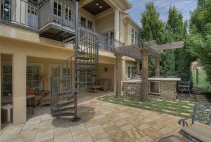 Mediterranean Patio with exterior stone floors, Pathway, Gate, Outdoor kitchen, Trellis, French doors, Fence