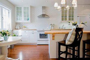 Traditional Kitchen with Glass panel, Kitchen island, Breakfast bar, Subway Tile, Chandelier, Breakfast nook, Raised panel