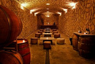 Rustic Wine Cellar with Deco home vintage sack ottoman, Built-in bookshelf, Wall sconce, sandstone floors, Standard height