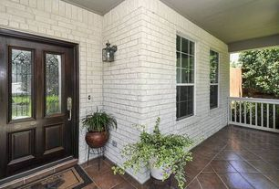 Traditional Porch with Glass panel door, exterior stone floors