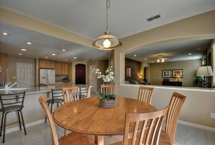 Traditional Dining Room with Pendant light, Columns, Concrete tile
