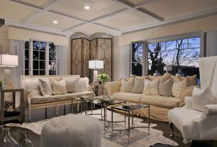 Contemporary Living Room with Animal hide rug, Crown molding, Pottery Barn PB Comfort Roll Arm Slipcovered Sofa, Area rug