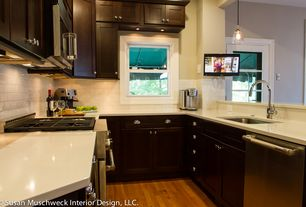 Modern Kitchen with Flat panel cabinets, Framed Partial Panel, U-shaped, Undermount sink, Corian counters, Subway Tile