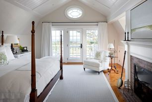 Traditional Master Bedroom with Box ceiling, French doors, can lights, specialty window, brick fireplace, High ceiling