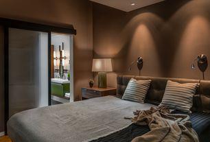 Modern Master Bedroom with can lights, Standard height, Laminate floors, sliding glass door, bedroom reading light