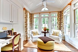Traditional Home Office with Exposed beam, Ceiling fan, Crown molding, Arched window, Hardwood floors, High ceiling