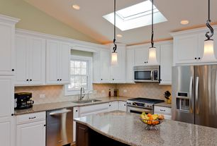 Traditional Kitchen with Over the range microwave, Kitchen island, Skylight, Quartz countertop, Pendant light, Stone Tile