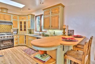 Country Kitchen with complex granite tile counters, Inset cabinets, U-shaped, Flat panel cabinets, Stone Tile, Limestone Tile