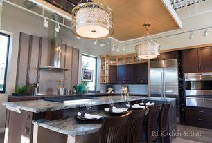 Modern Kitchen with Breakfast bar, Flat panel cabinets, Pental mountain white honed marble, Stone Tile, Travertine Tile