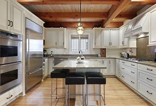 Traditional Kitchen with Simple Granite, Simple granite counters, Exposed beam, Raised panel, Flush, U-shaped, Kitchen island