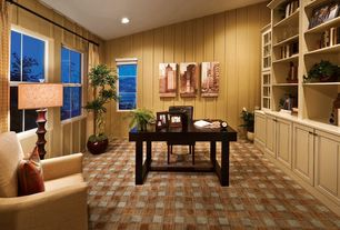 Traditional Home Office with Standard height, Stained glass window, specialty window, can lights, Built-in bookshelf, Carpet