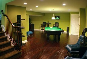 Traditional Game Room with Standard height, Pendant light, Built-in bookshelf, six panel door, can lights, Hardwood floors