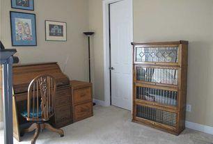 Traditional Home Office with Built-in bookshelf, six panel door, Standard height, Carpet