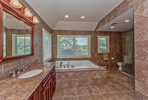 Traditional Master Bathroom with limestone tile floors, double-hung window, drop in bathtub, Standard height, can lights