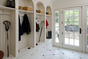 Cottage Mud Room with Built-in bookshelf, Emser metro black marble mesh-mounted mosaic tile, French doors, Crown molding