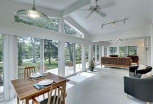 Contemporary Living Room with Exposed beam, specialty window, sliding glass door, flush light, Morris sofa, Standard height