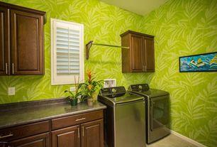 Craftsman Laundry Room with limestone floors, Built-in bookshelf, Drop-in sink, Hanging Bar, interior wallpaper