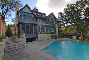 Craftsman Swimming Pool with Raised beds, exterior stone floors, French doors, Pathway, Infinity pool, Fence, Gate