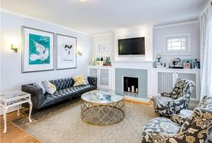 Eclectic Living Room with tv wall mount, Hardwood floors, flush light, Uttermost Quatrefoil Coffee Table, Crown molding