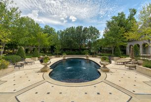 Traditional Swimming Pool with Pathway, Fountain, French doors, exterior stone floors, Fence, Transom window